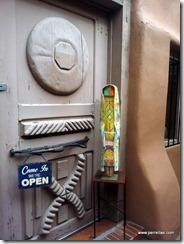 Hand carved door of an art gallery